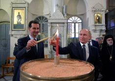 FILE PHOTO: Russian President Vladimir Putin and his Syrian counterpart Bashar al-Assad visit an Orthodox Christian cathedral in Damascus, Syria January 7, 2020. Sputnik/Alexei Druzhinin/Kremlin via REUTERS ATTENTION EDITORS - THIS IMAGE WAS PROVIDED BY A THIRD PARTY/File Photo