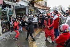 People dance at the Tajrish Bazaar, ahead of Nowruz, the Iranian New Year, amid the coronavirus disease (COVID-19) pandemic, in Tehran, Iran March 17, 2021. REUTERS./