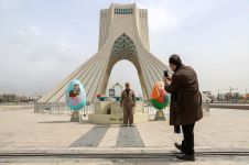 An Iranian man poses for a photo with Nowruz-themed decorations, ahead of Nowruz, the Iranian New Year, amid the coronavirus disease (COVID-19) pandemic, in Tehran, Iran March 17, 2021. REUTERS./