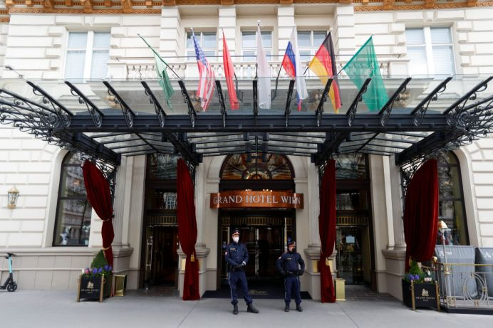 Police officers stand outside a hotel, where a meeting of the JCPOA Joint Commission or Iran nuclear deal will be held, in Vienna, Austria, April 15, 2021. REUTERS/Leonhard Foeger
