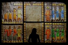 A V&A employee looks at colour images projected onto casts on loan from the British Museum, based on originals from the Palace of Darius, on display at Epic Iran, an exhibition soon to open at the V&A in London, Britain, May 25, 2021. Picture taken May 25, 2021. REUTERS/Peter Nicholls TPX IMAGES OF THE DAY