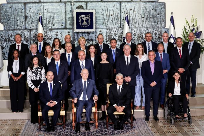 2021-06-14T082416Z_1734658173_RC280O9N6QBB_RTRMADP_3_ISRAEL-POLITICS-GOVERNMENT-FAMILY-PHOTO-scaled