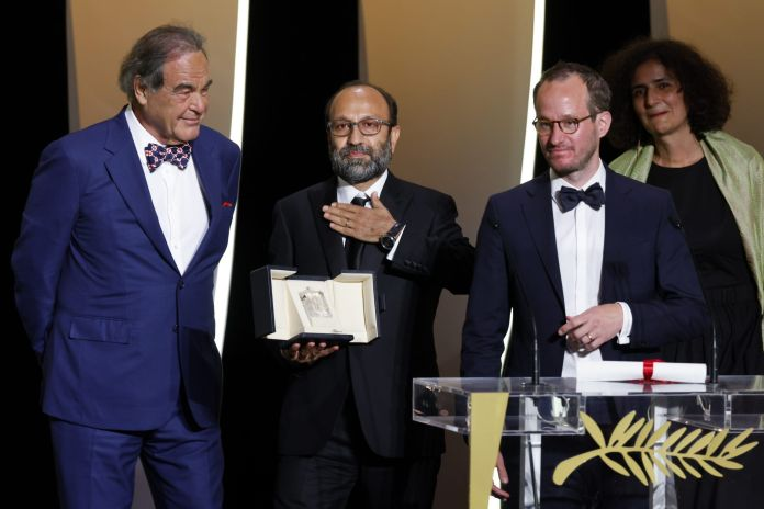2021-07-17T184711Z_1467840063_UP1EH7H1G6KW7_RTRMADP_3_FILMFESTIVAL-CANNES-AWARDS-scaled