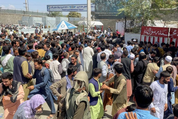 People try to get into Hamid Karzai International Airport in Kabul, Afghanistan August 16, 2021. REUTERS/