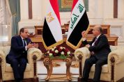 Iraq's President Barham Salih and Egyptian President Abdel Fattah al-Sisi speak ahead of the Baghdad summit at the Green Zone in Baghdad, Iraq August 28, 2021. REUTERS/Thaier Al-Sudani