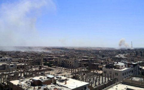 A view shows damaged buildings as smoke rises in Deraa, Syria on August 31, 2021. REUTERS./
