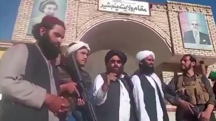 """Video on social media showed a group of Taliban members raising their flag outside the Panjshir provincial governor's compound, with one declaring, """"The capital of the Panjshir province is under the control of the Mujahideen.""""REUTERS./"""
