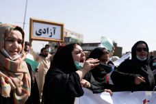 An Afghan woman uses a microphone to chant during the anti-Pakistan protest in Kabul, Afghanistan, September 7, 2021. REUTERS./