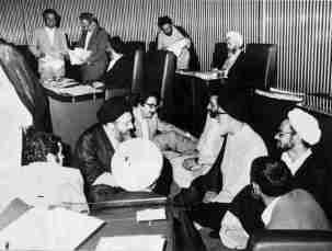 Bani-Sadr discussing the Islamic Republic's constitution in the Majlis, Iranian Parliament. Kayhan London./