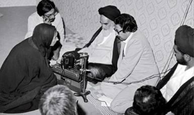 Bani-Sadr sitting next to Khomeini. Kayhan London./