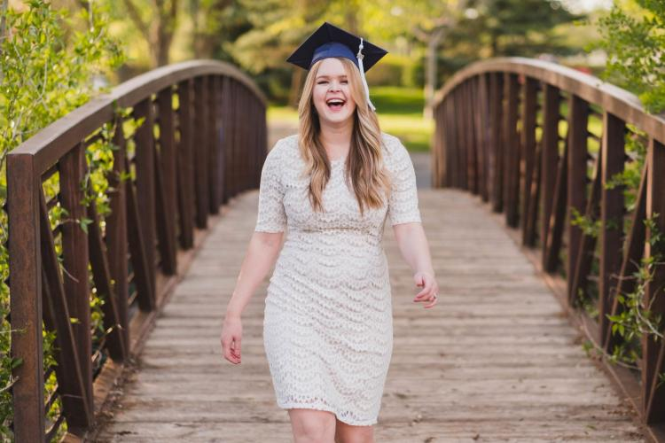 laughing in a graduation cap