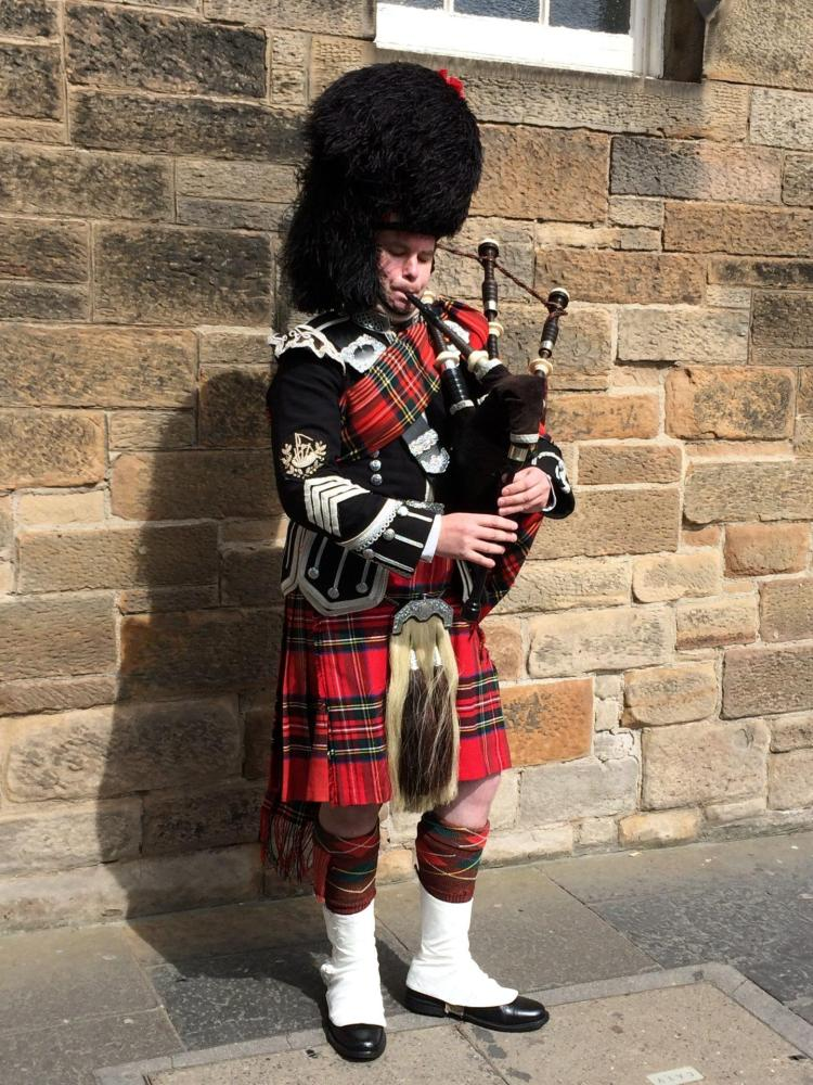 watching the bagpipe player is one of the many things to do in edinburgh