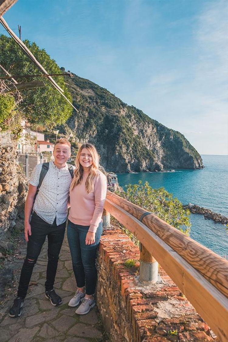 Kayla and Taz overlooking Riomaggiore in Cinque Terre, Italy