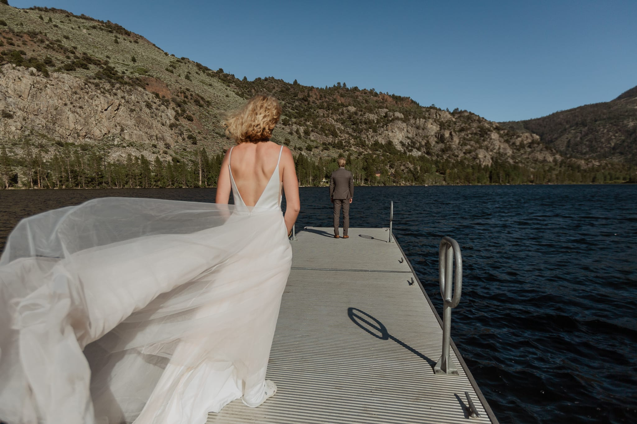 Haylee walks out to Tyler on the Silver Lake Dock for their first look.