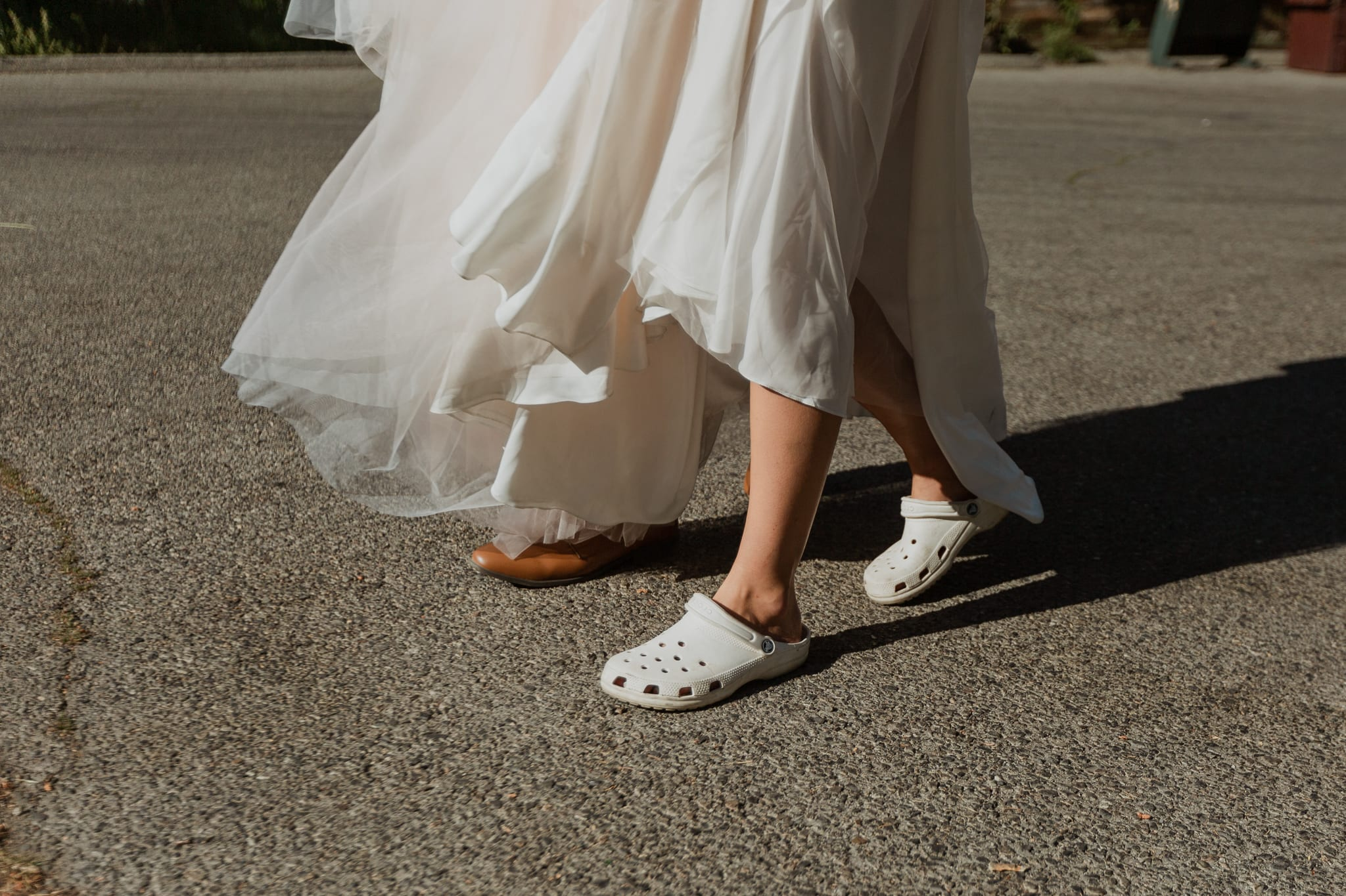 Haylee walks in her white crocs and wedding dress to go see Tyler for the first time on their elopement day.
