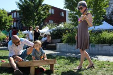 Camila Koul, joined by her husband Amit and son Kiran, 1, enjoyed the sunshine and played in the grass at Patricia's Green during the Urban Air Market on May 1, 2016.