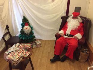 Santa Claus looking very comfy in his Grotto