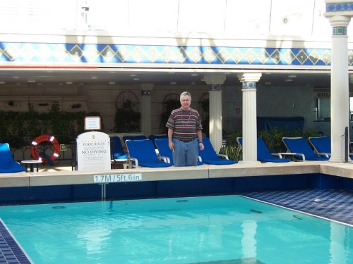 Hubby at solarium pool