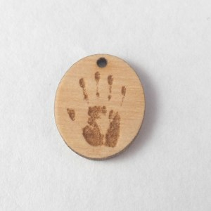 laser-etched handprint wooden charm