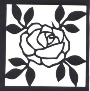 paper cut of rose on black paper