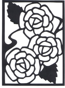paper cut of rose on black paper