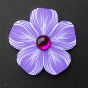 purple polymer clay petunia brooch with acrylic cabochon