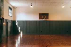interior of indoors basketball court in sports center