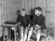 Original caption: Two young boys listen to a crystal radio set. Photograph ca. 1920. --- Image by © AS400 DB/Corbis