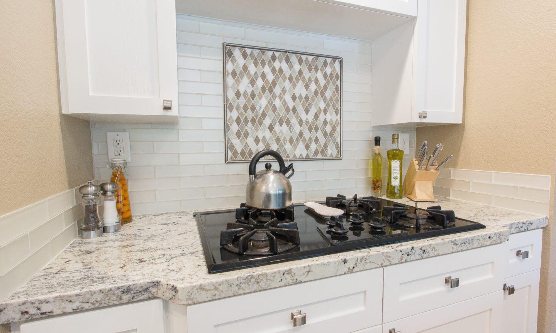 This Backsplash: Bedrosians Manhattan Pearl 2 X 8 Glass Tiles With  Bedrosians Decorative Rhomboid Blended Mosaic Tiles Framed By A Metallic  Bullnose Trim.