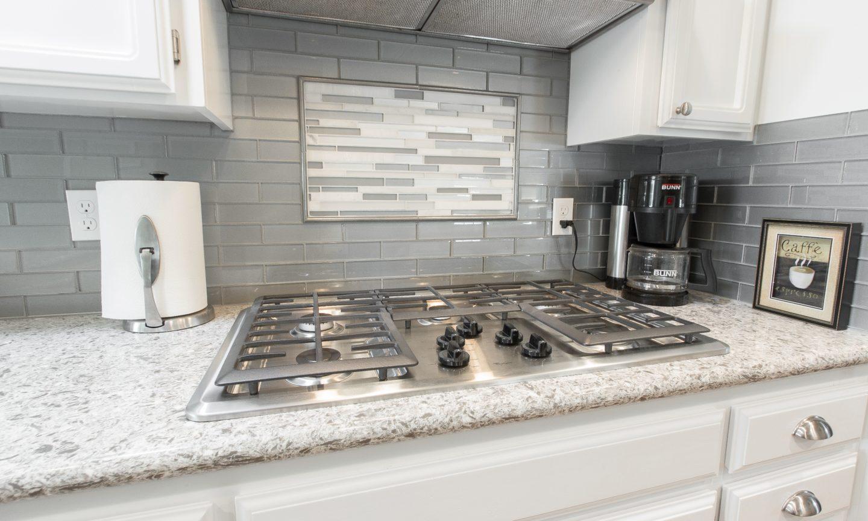 This Backsplash: Bedrosians Manhattan Platinum 2 X 8 Glass Tiles With An  Accent Of Bedrosians Manhattan Tribeca Random Interlocking Stone And Glass  Blend ...