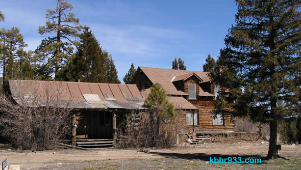 The cabin on the left will be moved to the Historical Museum; the building on the right will likely be demolished.