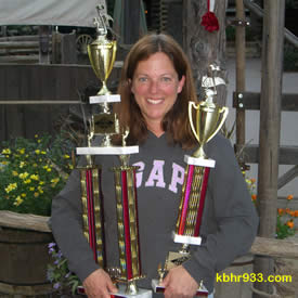 Director Sharon Rizzo with the 1st and 2nd place trophies