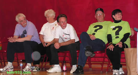 The Man About Town candidates, on the sidelines during a time-out in the fun Friday night game against the Harlem Ambassadors: (from left) Paul Ortuno, Helen Walsh, Ace Evers, Phil and Sue Hamilton.