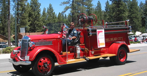 "Big Bear City Fire Captain Dave Delay drives the 1936 REO firetruck, described by CSD's Marge McDonald as an ""icon of Big Bear City."" The truck was purchased 73 years ago with funds generated by a community fundraiser spearheaded by the Peter Pan Club."