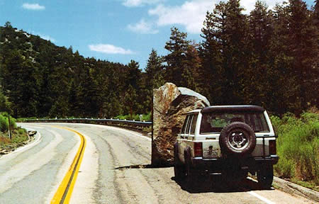 Rock 'n' roll: CalTrans employee Jeff Knott took this photo of a boulder that made its way onto Highway 38, just east of Barton Flats, due to the 6.4 magnitude quake on June 28, 1992.