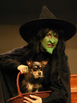 Elena Peavy as the Wicked Witch, with Mojo Willis as Toto.