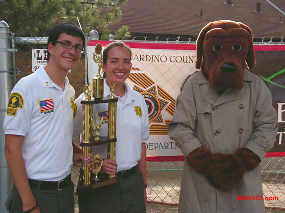 Big Bear Sheriff's Explorers Tyler Garland and Sarah Button, with their second place trophy and McGruff the Crime Dog (aka Deputy Wijnhamer) at yesterday's National Night Out event at the Convention Center.