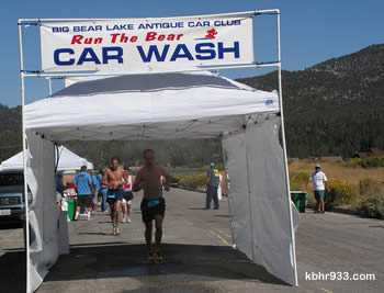 "The Big Bear Lake Antique Car Club's ""car wash"" was a welcome water spritzing for runners, at the marathon's turn-around on Sandalwood."