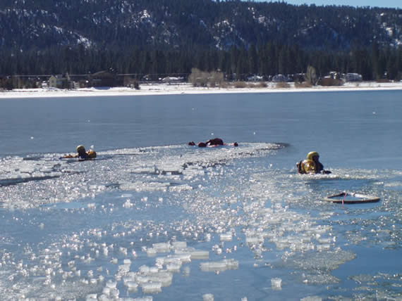 Firefighting crews (as seen here last January) train for lake ice rescue each year; it is illegal to go out on the lake ice, and violators may be ticketed and fined.