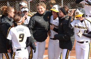Natalie Fleming is met at home plate by her teammates after hitting a home run in game two of the doubleheader on Wednesday, March 19, 2014.  Fleming is hitting .467 on the year.