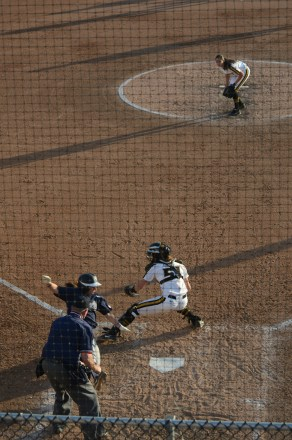 Mississippi third baseman Allison Brown evades the tag by Missouri catcher Sami Fagan to score the go-ahead run in the top of the seventh inning of game one of the doubleheader on Friday, April 18, 2014 at University Field in Columbia, Mo.