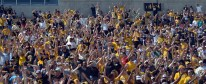 Fans perform the Missouri Waltz in between the third and fourth quarter during the MU spring football game on Saturday, April 19, 2014 at Memorial Stadium in Columbia, Mo. After the game, fans were allowed onto the field to get autographs and photos with players and coaches.