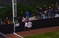 Alabama left fielder Kallie Case tries to catch a home run hit over the left field wall by Missouri right fielder Emily Crane on Thursday, May 1, 2014 at University Field in Columbia, Mo.