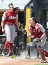 Alabama catcher Jordan Patterson and pitcher Leslie Jury celebrate after tagging out Carlie Rose at home to end the fifth inning on May 3, 2014 at University Field in Columbia, Mo. Jury pitched 5.1 innings and gave up no runs on only four hits.
