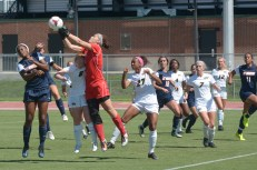 Tennessee-Martin goalie Mariah Klenke (in red) reaches up to grab a corner kick over Missouri's Rachel Hignett (8). Missouri players Jessica Johnson (27), Erin Webb (4), Kaitlyn Clark (7), and Macee Blanchard (12) attempt to fight off Skyhawk defenders Saphyra Coombs-James (13), Taylor Fry (18) and Rianna Jarrett (11). The Tigers challenged Klenke with 15 shots during the match, nine of which were on goal. (Greg Dailey)