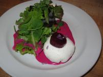An amazing first course for a fellow chef - beet filled goat cheese sphere.