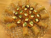 Spring rolls and hominy cakes with sour cream.