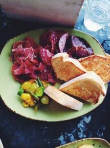 Charcuterie plate: serrano jamon, wagyu bresola, sopressa salami, piccalilli, sourdough bread
