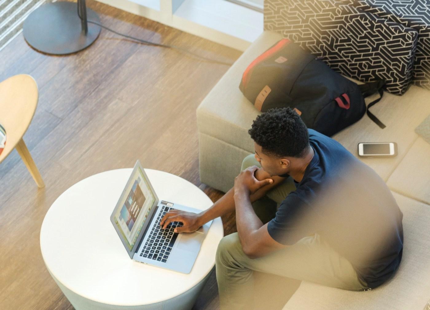 image of black man on computer