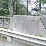 Cracked concrete and an outdated metal rail will be removed and replaced with a safer and historically accurate rail.  (Oregon Department of Transportation photo).